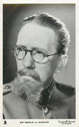 SIR GERALD DU MAURIER  faces front, looks left, wears glasses