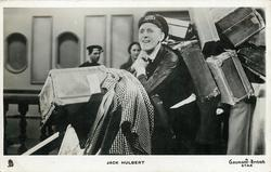 JACK HULBERT  as railway porter with lots of luggages