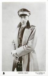 CONRAD VEIDT  in uniform, wears monocle