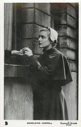 MADELEINE CARROLL  looks up at open window, other person not visible only a hand