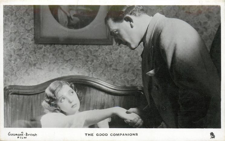 THE GOOD COMPANIONS  seated girl takes the hand of standing man