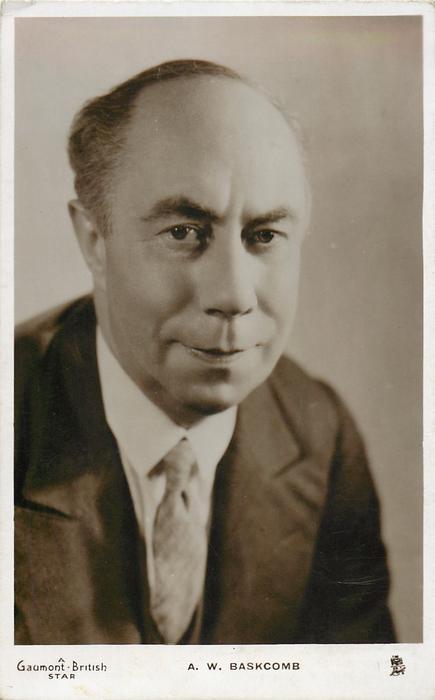 A.W. BASKCOMB  faces & looks front, wears suit