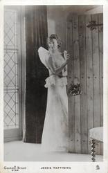 JESSIE MATTHEWS  in evening dress prepares to leave, hand on door
