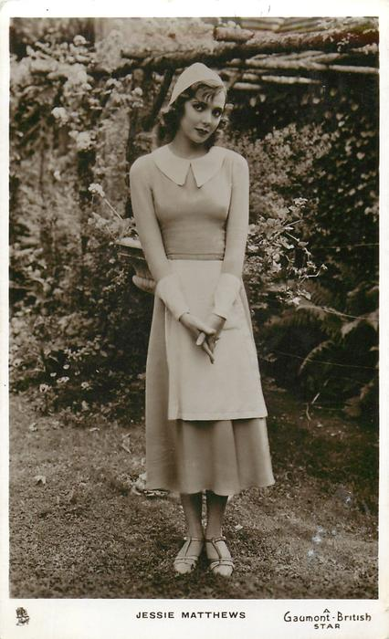 JESSIE MATTHEWS  standing in maids uniform