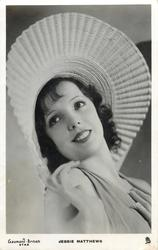 JESSIE MATTHEWS  wears large rimmed hat