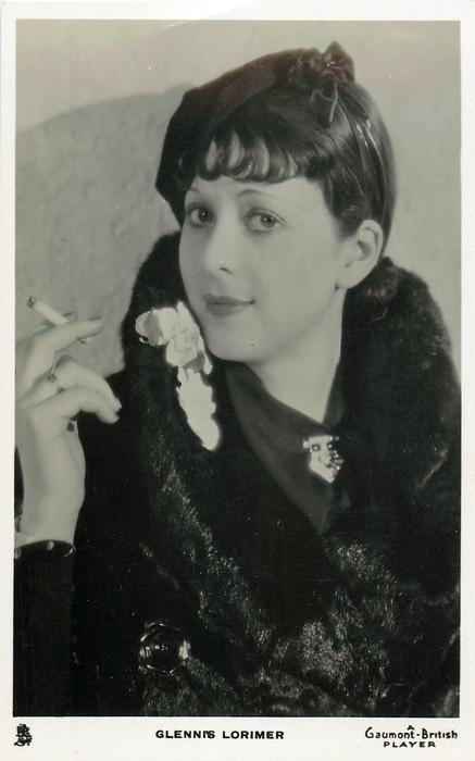 GLENNIS LORIMER  smoking, wearing fur