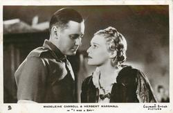 "MADELEINE CARROLL & HERBERT MARSHALL IN ""I WAS A SPY""  they look at each other"