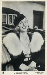 "VERONICA ROSE IN "" A CUCKOO IN THE NEST""  she is smiling, wears fur, sitting in car rear seat"