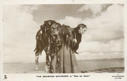 "THE SEAWEED GATHERER IN ""MAN OF ARAN""  she carries bag"