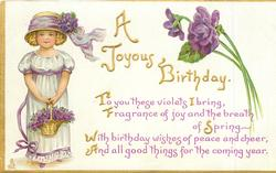 A JOYOUS BIRTHDAY girl stands with basket of violets