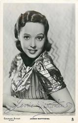 JESSIE MATTHEWS  only upper body visible, faces left, looks front, both arm in front of her