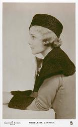 MADELEINE CARROLL  half length study, looks & faces left, wears hat, coat