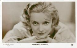 MADELEINE CARROLL  head & shoulder study, looking up & front, both hand under her chin
