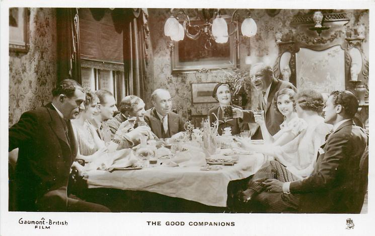 THE GOOD COMPANIONS  group of ten seated round much used dining table