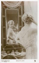 EVELYN LAYE  looking in mirror