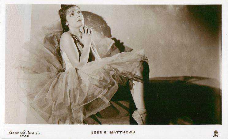 JESSIE MATTHEWS  seated, in dance costume