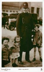 JACK HULBERT  as policeman, with three children