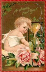 A HAPPY NEW YEAR infant sitting next to hour glass