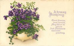 A HAPPY BIRTHDAY bowl of violets