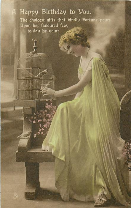 A HAPPY BIRTHDAY TO YOU  girl with bird in cage looks down at another perched on seat