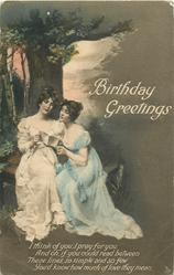 BIRTHDAY GREETINGS  two women sit beneath tree sharing a letter