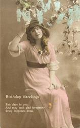 BIRTHDAY GREETINGS  girl sits on step-ladder, hand on hat, flowers upper right