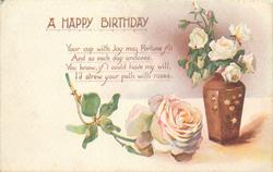 A HAPPY BIRTHDAY single rose left, vase of roses right