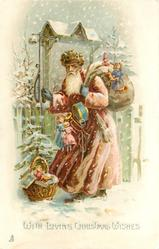 WITH LOVING CHRISTMAS WISHES  purple robed Santa, burdened with toys, at gate in snow