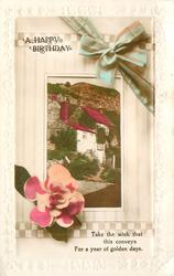 A HAPPY BIRTHDAY inset houses on hillside, flower, bow & ribbon