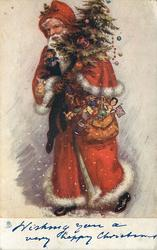 WISHING YOU A VERY HAPPY CHRISTMAS  red robed Santa walks left loaded with gifts & tree