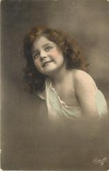 young girl poses, facing left & looking up, left shoulder bare