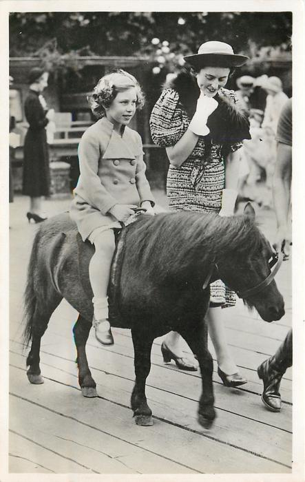 H.R.H. THE PRINCESS MARGARET ROSE AT THE ZOOLOGICAL GARDENS  riding pony beside woman