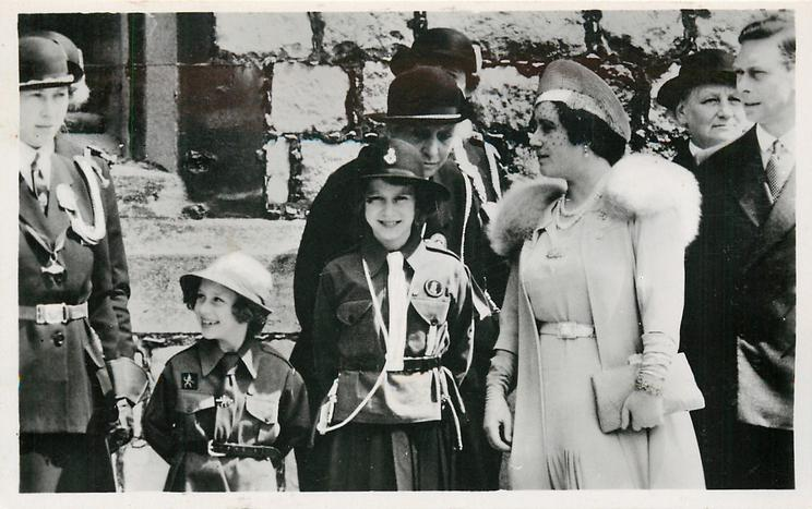 Ki(ng George VI and Queen Elizabeth, two Girl Guides & leader in uniform left