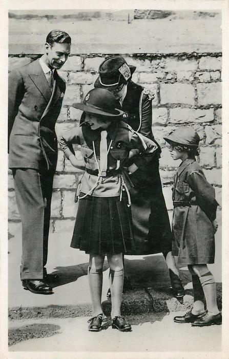 King George VI watches as leader adjusts Girl Guides uniform