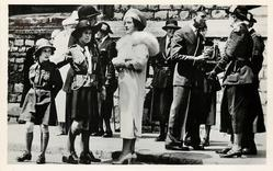 Queen talks to Girl Guides, the King George VI talks with their leaders