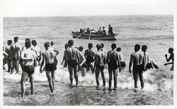 King George VI coming ashore to visit camp for boys