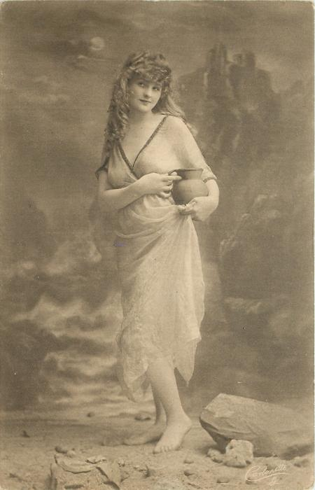 moonlit rocky beach scene, girl poses with water pitcher on her left hip, she faces front & looks left