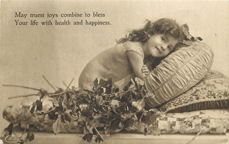 MAY TRUEST JOYS COMBINE TO BLESS...  HEALTH AND HAPPINESS flowers in front, she leans forward on pillow