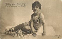 WISHING YOU A FUTURE BRIGHT....AND DELIGHT boy sitting on table, flowers in front