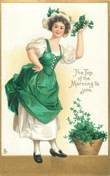 THE TOP OF THE MORNING TO YOU  girl holds up shamrock