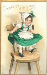 """THE WEARING OF THE GREEN.""  girl stands on chair, with both hands holds skirt"