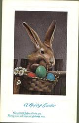 A HAPPY EASTER  rabbit behind basket of Easter eggs