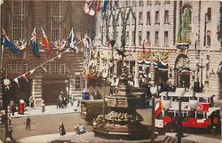 THE SILVER JUBILEE DECORATIONS AT PICCADILLY CIRCUS FROM A PHOTOGRAPH TAKEN IN ACTUAL COLOUR