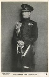 H.R.H. THE DUKE OF WINDSOR or HIS MAJESTY KING EDWARD VIII  almost full length, hands clasped on sword hilt, facing half left