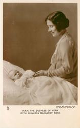H.R.H. THE DUCHESS OF YORK WITH PRINCESS MARGARET ROSE  who is lying on cot