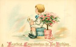 HEARTIEST CONGRATULATIONS FOR YOUR BIRTHDAY  boy sitting holding hat next to pot rose