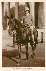 HIS MAJESTY KING GEORGE V or H.M. THE KING, on horseback riding forward left