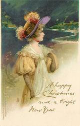A HAPPY CHRISTMAS AND A BRIGHT NEW YEAR  girl in yellow/white outfit & ornate purple hat, looks right