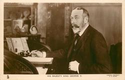 HIS MAJESTY KING GEORGE V at his desk