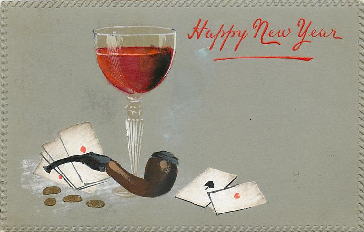 HAPPY NEW YEAR  glass of red wine, four coins, cards, grey background